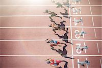sprint - Runners taking off from starting blocks on track Stock Photo - Premium Royalty-Freenull, Code: 6113-07730484