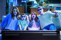 Family watching 3D television in living room Stock Photo - Premium Royalty-Freenull, Code: 6113-07730531
