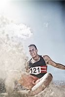 Long jumper landing in sand Stock Photo - Premium Royalty-Freenull, Code: 6113-07730603