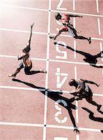 finish line - Runners crossing finish line Stock Photo - Premium Royalty-Freenull, Code: 6113-07730606