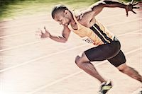 fit people - Sprinter racing on track Stock Photo - Premium Royalty-Freenull, Code: 6113-07730607