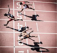 runner (male) - Runners crossing finish line on track Stock Photo - Premium Royalty-Freenull, Code: 6113-07730615