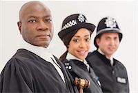 Portrait of confident judge and police Stock Photo - Premium Royalty-Freenull, Code: 6113-07730621