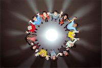 strategy - Diverse crowd around bright light Stock Photo - Premium Royalty-Freenull, Code: 6113-07730636