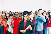 Crowd clapping behind happy graduate Stock Photo - Premium Royalty-Freenull, Code: 6113-07730639