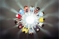 strategy - Crowd forming circle around bright light Stock Photo - Premium Royalty-Freenull, Code: 6113-07730645