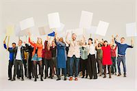 person holding sign - Diverse crowd with picket signs Stock Photo - Premium Royalty-Freenull, Code: 6113-07730652