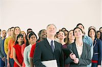 Crowd of business people looking up Stock Photo - Premium Royalty-Freenull, Code: 6113-07730673
