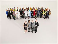 Workforce behind confident business people Stock Photo - Premium Royalty-Freenull, Code: 6113-07730676