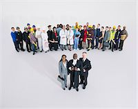 Workforce behind confident lawyers and judge Stock Photo - Premium Royalty-Freenull, Code: 6113-07730678