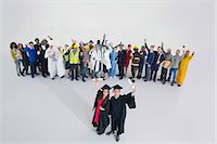 female police officer happy - Workforce cheering behind confident graduates Stock Photo - Premium Royalty-Freenull, Code: 6113-07730685