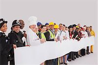 Portrait of diverse workforce with blank signs Stock Photo - Premium Royalty-Freenull, Code: 6113-07730702