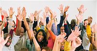 Portrait of diverse crowd cheering Stock Photo - Premium Royalty-Freenull, Code: 6113-07730721