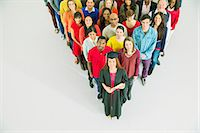 Diverse crowd behind confident graduate Stock Photo - Premium Royalty-Freenull, Code: 6113-07730725