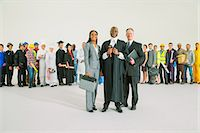 Workforce behind confident judge and lawyers Stock Photo - Premium Royalty-Freenull, Code: 6113-07730738