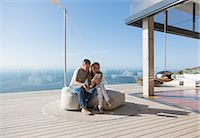 Couple using digital tablet on modern balcony Stock Photo - Premium Royalty-Freenull, Code: 6113-07730802