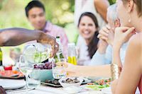 Friends eating together outdoors Stock Photo - Premium Royalty-Freenull, Code: 6113-07730878