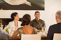 Friends laughing at dinner party Stock Photo - Premium Royalty-Freenull, Code: 6113-07731003