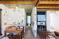 Kitchen and living area of rustic house Stock Photo - Premium Royalty-Freenull, Code: 6113-07731065