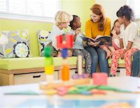 story - Teacher and students reading in classroom Stock Photo - Premium Royalty-Freenull, Code: 6113-07731135
