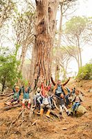 Teacher and students cheering in forest Stock Photo - Premium Royalty-Freenull, Code: 6113-07731143