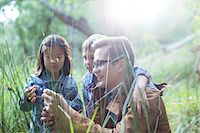 Students and teacher examining grass in forest Stock Photo - Premium Royalty-Freenull, Code: 6113-07731147