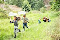 Children playing with butterfly nets on dirt path Stock Photo - Premium Royalty-Freenull, Code: 6113-07731160