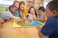 Children and teacher playing in class Stock Photo - Premium Royalty-Freenull