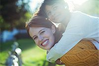 Mother carrying daughter on shoulders Stock Photo - Premium Royalty-Freenull, Code: 6113-07731167