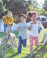 filipino - Children running on playground Stock Photo - Premium Royalty-Freenull, Code: 6113-07731196