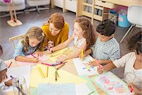 Students and teacher drawing in classroom Stock Photo - Premium Royalty-Freenull, Code: 6113-07731209