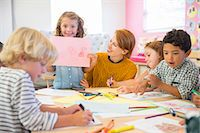 Student showing off drawing in classroom Stock Photo - Premium Royalty-Freenull, Code: 6113-07731219
