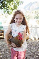Girl holding chicken at petting zoo Stock Photo - Premium Royalty-Freenull, Code: 6113-07731317
