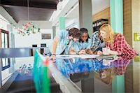 People working together in office Stock Photo - Premium Royalty-Freenull, Code: 6113-07731369