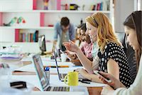 People working at conference table in office Stock Photo - Premium Royalty-Freenull, Code: 6113-07731503