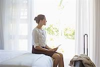 Businesswoman using digital tablet in hotel room Stock Photo - Premium Royalty-Freenull, Code: 6113-07731655