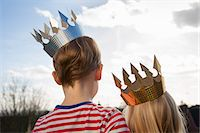 Two children in fancy dress, wearing crowns. Stock Photo - Premium Royalty-Freenull, Code: 6118-07731703