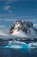 extreme terrain - Icebergs floating in the water off the rocky shore of Antarctica. Stock Photo - Premium Royalty-Freenull, Code: 6118-07731769