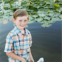 fishing - A young boy standing in shallow water with a fishing net. Stock Photo - Premium Royalty-Freenull, Code: 6118-07732015