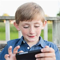 A young boy outdoors. Stock Photo - Premium Royalty-Freenull, Code: 6118-07732044