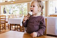 2 years old girl eating an ice cream in a dining room, Sweden Stock Photo - Premium Rights-Managednull, Code: 700-07734374