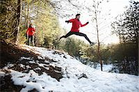 Two runners on forest road in winter Stock Photo - Premium Royalty-Freenull, Code: 613-07734583