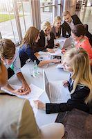 Businessmen and businesswomen at brainstorming meeting Stock Photo - Premium Royalty-Freenull, Code: 614-07735341
