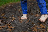 Muddy feet of four year old girl standing in garden soil Stock Photo - Premium Royalty-Freenull, Code: 614-07735501