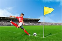 Soccer Player Taking Corner Kick Stock Photo - Premium Royalty-Freenull, Code: 622-07736019
