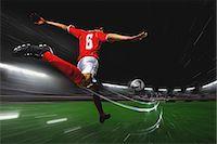 Soccer Player Kicking The Ball Stock Photo - Premium Royalty-Freenull, Code: 622-07736028