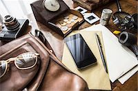 Still life of group of vintage objects with smartphone Stock Photo - Premium Royalty-Freenull, Code: 649-07736484