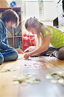 Brother and sister counting coins from savings jar Stock Photo - Premium Royalty-Freenull, Code: 649-07736736