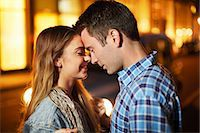 Romantic couple face to face city street at night Stock Photo - Premium Royalty-Freenull, Code: 649-07737020