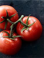 slate - Tomatoes on the vine Stock Photo - Premium Royalty-Freenull, Code: 659-07739593